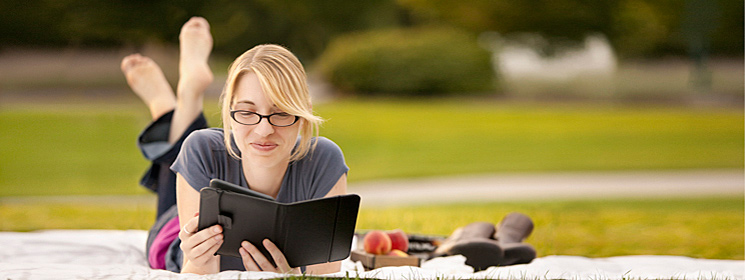 woman reading eReader