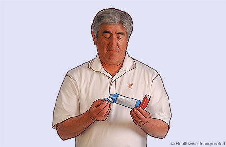 Picture of a man removing the cap from the spacer
