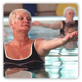 Photo of a woman doing aerobic exercise in a swimming pool