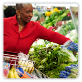 Photo of a woman shopping for fresh vegetables